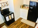 Full Kitchen with Microwave, Keurig supplied coffee, and glass top full stove