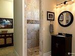 Ensuite Bathroom with luxury walk-in shower, closet, toilet, and vanity.