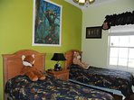 Jungle room, twin beds, sleeps two. 24' TV. close to pool bath. and master.