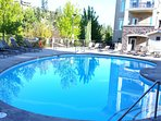 Large heated pool and hot tub area, vending machines for snacks & drinks, and gym