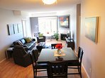 Bright open concept, dining for 8, electric fireplace, free wifi, large screen tv, cable, games,...