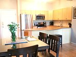Fully equipped Kitchen features new stainless steel fridge, convection range, dishwasher, microwave