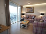 Wonderfully light and airy open plan living space. Balcony with seating and views over the town