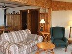 Living room and doors to bedrooms