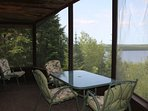 View looking northwest onto Moose lake and screened in porch