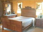 Eastlake double bed with marble-top dressers, south side upstairs.