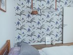 Ferm Living clothes' rack and Cole & Son's wallpaper