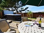 Patio area with garden furniture and hot tub