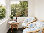 Relax and unwind in the sun trap conservatory