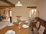 Ample dining space around the farmhouse table