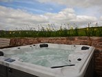 The hot tub with fabulous countryside views