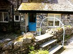 The quaint entrance to this lovely property