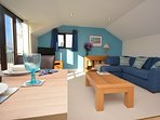 The delightful lounge area has a juliet balcony
