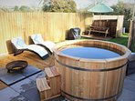 Simply fire up the wood-fuelled hot tub and relax under the stars