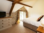 King-size bedroom with dormer window and stunning countryside views