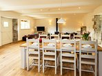 Lounge/diner with oak flooring and exposed beams