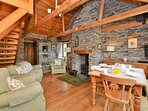 Comfortable lounge/dining area with woodburner