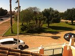 The park with car parking in front of the villa