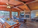Enjoy home-cooked meals along this long dining table.