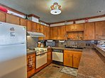This kitchen comes fully equipped to handle all your cooking needs.