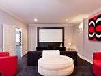 Two level movie theater room with projector