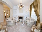 Stunning formal living area with fireplace greets you from the entrance