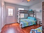 Kids will love sharing this bedroom with 2 twin-over-full bunk beds.