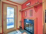 Stoke the wood-burning fireplace when it gets cold.