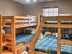 The third bedroom has 2 bunk beds.