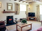 The woodburning stove is a lovely focal point to the living room