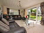 Lounge with patio doors leading to the garden