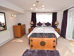 Double bedroom accessed by an archway from the lounge