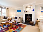 Spacious lounge area with woodburner