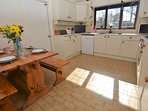 Kitchen leading to the utility room