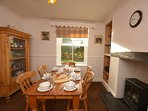 Cosy dining room with feature freplace and garden views