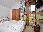 Double bedroom with double height window