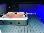 Relax under the stars in the hot tub