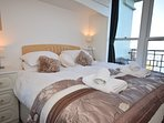 Double bedroom with super king-size bed and wonderful sea views
