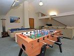 Mezzanine games room looking over open-plan living space
