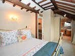 Master bedroom with traditional wooden beams