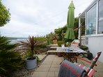 Enjoy alfresco dining or a cup of tea with sea views