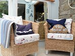 Relax in an armchair and gaze out to sea