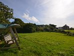 Shared paddock with swing seat and stunning countryside views