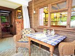 Enjoy the views from the enclosed porch area