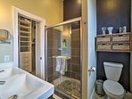 The first full bathroom has a stand-up shower, single sink, and walk-in closet.