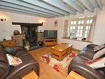 Lounge with feature fireplace and woodburner