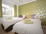 Twin zip-and-link bedroom which can be made up a a king-size on request