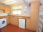 Utility room with laundry facilities
