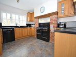 Extremely sociable kitchen leading from the dining area with Range oven