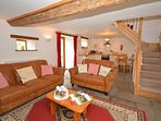Open-plan lounge/kitchen/diner with cottage style stairs